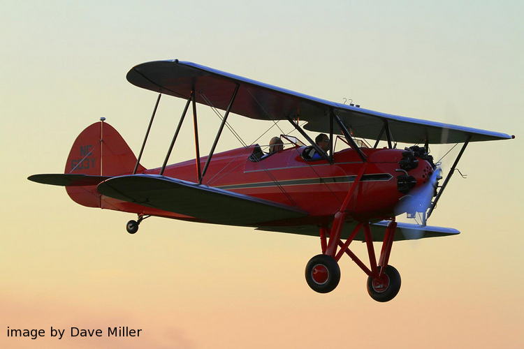 biplanes at sunset